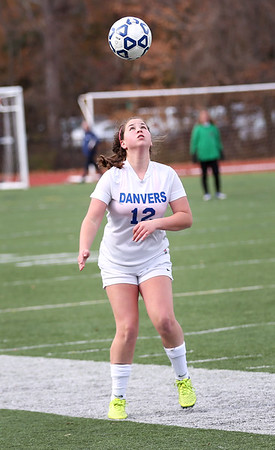HADLEY GREEN/Staff photo<br /> Danvers' Erica Blanch (12) does a header at the Medway v. Danvers Division 2 girls soccer state championship game at Fitchburg State University.<br /> <br /> 11/18/17