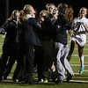 HADLEY GREEN/Staff photo<br /> Danvers players surround their goalie Julia Pitman in celebration after winning against Beverly. <br /> <br /> 11/04/17