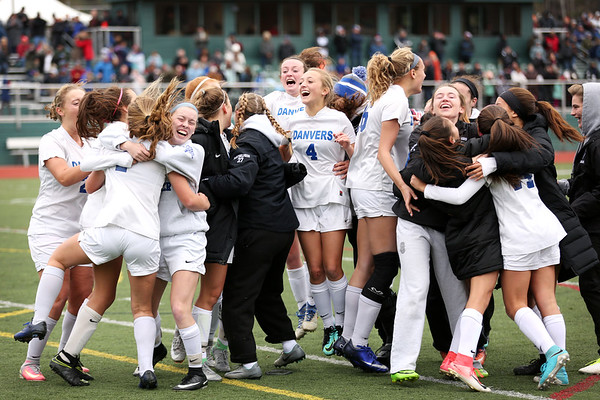 HADLEY GREEN/Staff photo<br /> Danvers players celebrate after Lydia Runnals (1) scores the winning penalty shot after two overtimes at the Medway v. Danvers Division 2 girls soccer state championship game at Fitchburg State University.<br /> 11/18/17
