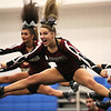 HADLEY GREEN/Staff photo<br /> Cheerleaders Rilee Newhall, center, and Vanessa Rodolosi compete onstage at the Massachusetts State Cheerleading Tournament at Worcester State University.<br /> <br /> 11/19/17