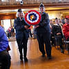 HADLEY GREEN/Staff photo<br /> Veterans Marion Rudolph and Donna Janesky present the wreath for female veterans at Peabody's Veterans Day service at Peabody City Hal.<br /> 11/11/17