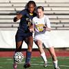 Bishop Fenwick sophomore midfielder Hannah Durkin (14) attacks St. Mary's freshman forward Marnelle Garraud (12) as she tries to protect the ball. DAVID LE/Staff photo. 10/20/14.