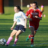 Peabody freshman Jillian Arigo (25) plays the ball upfield while being chased down by Salem senior captain Katherine Towey (19). DAVID LE/Staff photo. 10/17/14.