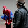 KEN YUSZKUS/Staff photo. Jordan Staples of Salem dressed as spiderman interacts with pedestrians on Essex Street in Salem.  10/03/14