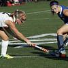 KEN YUSZKUS/Staff photo. Beverly's Ariel Levine left, and Danvers' Annie Tarricone smash sticks during Danvers at Beverly field hockey.   10/14/14
