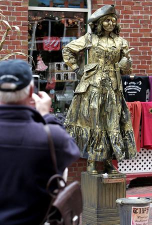 KEN YUSZKUS/Staff photo. Antonia Tsangaris of Dorchester is a living statue performing on Essex Street in Salem.  10/03/14