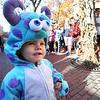 KEN YUSZKUS/Staff photo. Bryan Jackson, 2, of Salem, is dressed in his Halloween costume while walking along the Essex Street pedestrian mall in Salem.  10/30/14