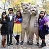 From left, Pooja Nagda, and Darshan Kothari, of Boston, and Katrina Abdalla, Ramesh Cherukuri, Arpan Patel, and Shivani Patel, of Syracuse, NY, pose for a photo on Salem Common on Friday afternoon. DAVID LE/Staff photo. 10/31/14.