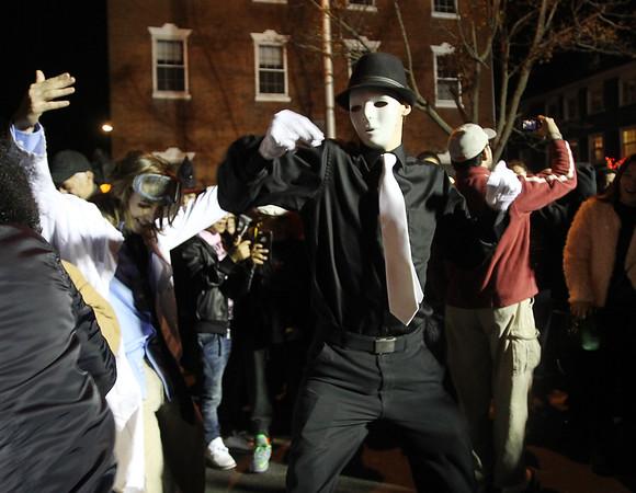 DAVID LE/Staff photo. A big dance circle was formed on Washington Street East near a DJ stand on Halloween evening. 10/31/15.