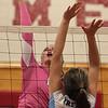 DAVID LE/Staff photo. Masco senior Lauren Butt spikes the ball over the net against Triton on Thursday. 10/22/15.