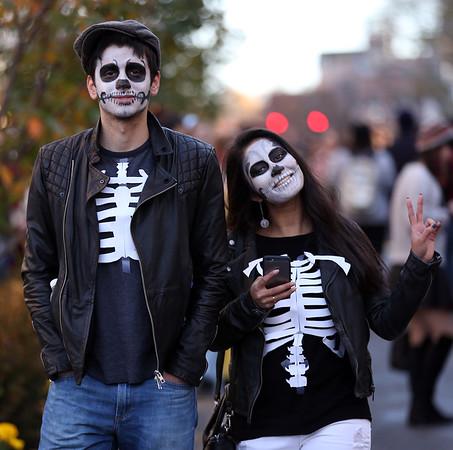 DAVID LE/Staff photo. Leonidas Chatzimichalis and Yusra Wahab, of Boston, walk across Washington Square East past the Hawthorne Hotel on Saturday afternoon. 10/31/15.