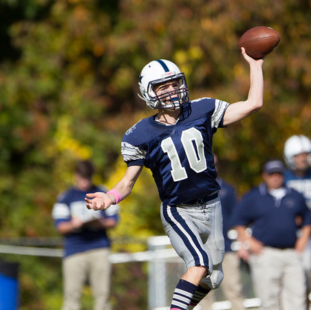 Jared Charney / Photo Hamilton-Wenham's Billy Whelan fires a pass against Amesbury, Saturday, October 15, 2016.