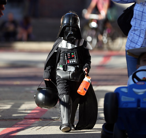 DAVID LE/Staff photo. Five-year-old Adrian Cardoza, of Salem, wanders down Artist's Row while dressed as Darth Vader on Friday afternoon. 10/7/16.