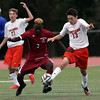 DAVID LE/Staff photo. Beverly junior Ryan Kalampalikas (13) and Gloucester junior captain Joe Kibango (3) battle for the ball. 9/28/16.