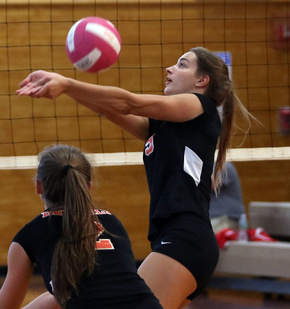 DAVID LE/Staff photo. Beverly junior Marlee Hamor bumps the ball over the net against Masco. 10/4/16.