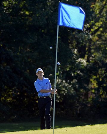 RYAN HUTTON/ Staff photo<br /> St. John's Prep's Griffin Chenard, 18, chips his ball onto the 13th hole's green during practice at the Middleton Golf Course on Wednesday.
