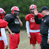 DAVID LE/Staff photo. Salem football head coach Matt Bouchard instructs his defense during practice on Wednesday. 9/28/16.