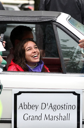 DAVID LE/Staff photo. Topsfield native, former Masco cross country and track standout, and Olympic distance runner Abbey D'Agostino, smiles while chatting prior to the start of the Topsfield Fair Parade on a rainy Saturday morning, where D'Agostino served as the Grand Marshal. 10/1/16.
