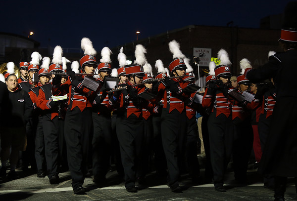DAVID LE/Staff photo. The Salem High School marching band plays a tune while marching down Derby street on Thursday evening. 10/6/16.