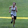 DAVID LE/Staff photo. Beverly freshman Jackson Wood sprints towards the finish line to capture the top spot in the Panthers cross country meet against Salem. 10/11/16.