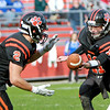 Beverly's Kevin Morency passes ball to Kyle Chouinard in a game Saturday, October 15, against Danvers at Hurd Stadium. Photo by Nicole Goodhue Boyd