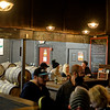 RYAN HUTTON/ Staff photo<br /> The tap room at Far From The Tree on Jackson Street in Salem was packed on Thursday night.