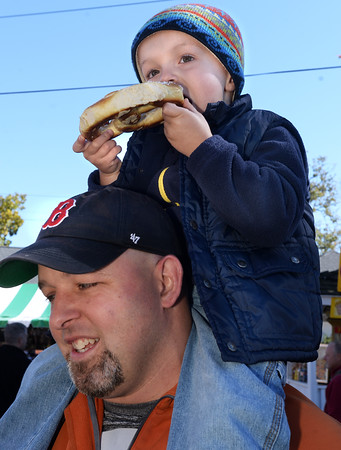 CARL RUSSO/Staff photo. After a rainy Sunday, thousands of people came out to enjoyed themselves on the last day of the 198th. Topsfield Fair. America's oldest fair. Ronan Murphy, 3 of Beverly enjoys his large pretzel on the shoulders of his father, Tim Murphy.10/10/2016