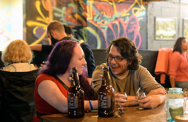 RYAN HUTTON/ Staff photo<br /> Katie Hill, of Salem, and John Oellette, of Peabody enjoy some hard cider at Far From The Tree on Jackson Street in Salem on Thursday night.