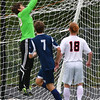 Ipswich goalie Nick Roesler grabs the corner ball to prevent a Hamilton-Wenham goal.<br /> <br /> Photo by JoeBrownPhotos.com