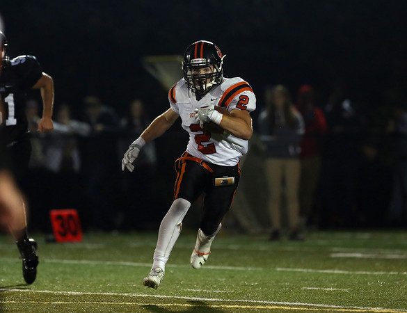 DAVID LE/Staff photo. Beverly senior captain Kyle Chouinard (2) tries to find running room against Marblehead 10/7/16.