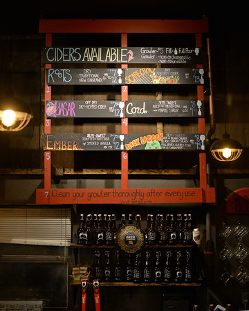 RYAN HUTTON/ Staff photo<br /> The six ciders available in the tap room at Far From The Tree Hard Cider on Jackson Street.