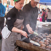 PARKER FISH/ Photo. Shelley Nason (left) and Matt Bongiorno (right) of A&B Burgers flip burgers on Cabot Street during the Beverly Block Party. 9/17/16