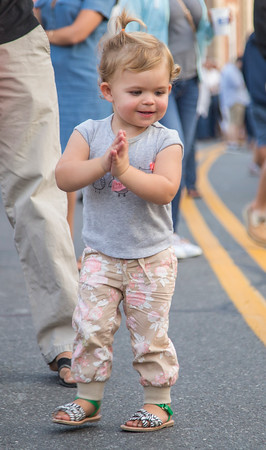PARKER FISH/ Photo. One year old Olive Stafford dances in the street to the music of the live entertainment during the Beverly Block Party. 9/17/16