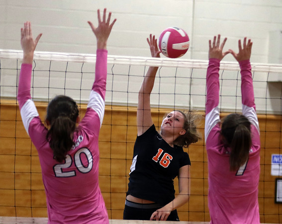 DAVID LE/Staff photo. Beverly senior Gracie Sparkman (16) spikes the ball through the outstretched hands of two Masco players. 10/4/16.