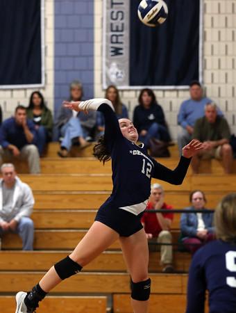 DAVID LE/Staff photo. Hamilton-Wenham junior Lauren Flynn leaps high in the air while smashing a kill over the net against Masco on Wednesday. 10/12/16.