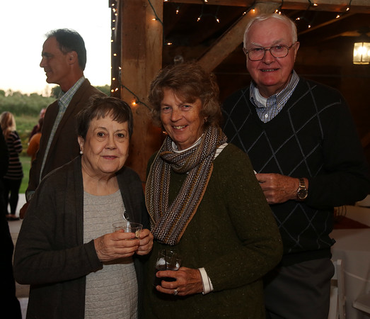 DAVID LE/Staff photo. Library Trustee Anne Quinn, left, with Barbara and Bob Davis, at the Starry, Starry Night Fundraiser held at the Smith Barn on Brooksby Farm. 10/6/16.