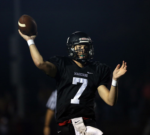 DAVID LE/Staff photo. Marblehead senior quarterback Drew Gally (7) fires a pass to his right against Beverly on Friday evening. 10/7/16.