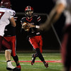 DAVID LE/Staff photo. Salem senior captain Jared Lubas (1) drops back to pass against Gloucester on Friday evening. 10/14/16.