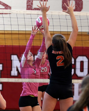 DAVID LE/Staff photo. Masco junior captain Lindsey Williams pushes the ball over the net and over the block attempt from Beverly junior Katie Noonan (2). 10/4/16.