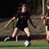 DAVID LE/Staff photo. Beverly senior captain Natalie Mellinger (10) plays the ball upfield against Swampscott. 10/6/16.