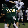DAVID LE/Staff photo. Danvers senior Jack Anderson (6) leaps in the air as he tries to deflect a pass from Lynn Classical quarterback Matt Lauria (12). 9/30/16.