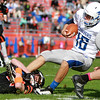 Danvers' Dean Borders carries the ball as Beverly's Johnny Jones pulls him down in a game Saturday, October 15, at Hurd Stadium. Photo by Nicole Goodhue Boyd