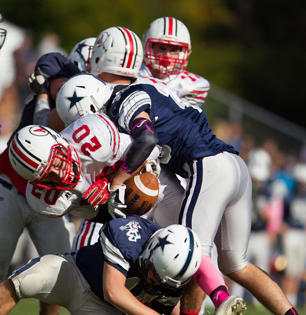 Jared Charney / Photo Hamilton-Wenham's Bryce Bucci forces a fumble from Amesbury's Nolan Gouin, Saturday, October 15, 2016.
