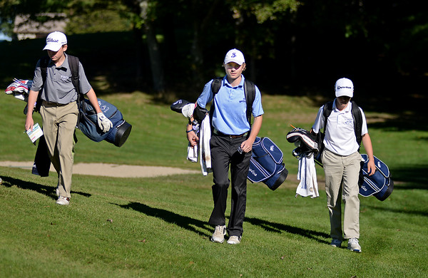 RYAN HUTTON/ Staff photo<br /> St. John's Prep's Griffin Chenard, 18, walks with teammates Brendon Ziegler, 15, left, and Drew Semons, 15, right, down the 12th hole fairway during practice at the Middleton Golf Course on Wednesday.