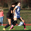 DAVID LE/Staff photo. Swampscott senior Ellie Wright (13) controls the ball while Beverly freshman Klaudia Rushi, left, pressures her. 10/6/16.