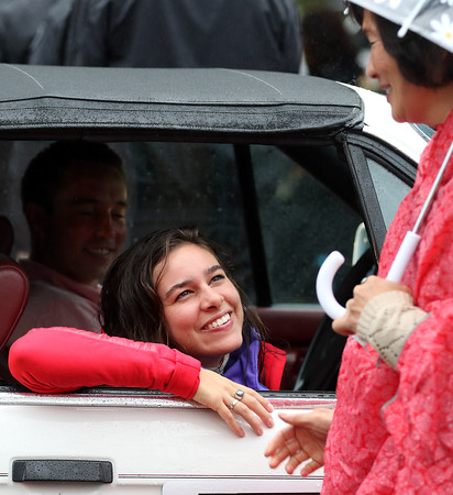 DAVID LE/Staff photo. Topsfield native and Olympian Abbey D'Agostino, is warmly greeted by fans at the start of the Topsfield Fair Parade on a rainy Saturday morning, where D'Agostino served as the Grand Marshal. 10/1/16.