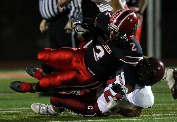 DAVID LE/Staff photo. Salem running back Vinny Gaskins (2) plows through a tackle from Gloucester sophomore Marc Smith (32). 10/14/16.