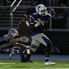 DAVID LE/Staff photo. Danvers wide receiver Tahg Coakley (7) streaks down the sideline after hauling in a pass from quarterback Dean Borders. 10/21/16