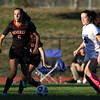 DAVID LE/Staff photo. Beverly sophomore Anna Edson (6) carries the ball up the field while being chased down by Swampscott senior Ellie Wright. 10/6/16.