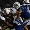 DAVID LE/Staff photo. Peabody junior fullback Eric DeMayo (44) plows his way into the teeth of the Danvers defense. 10/21/16